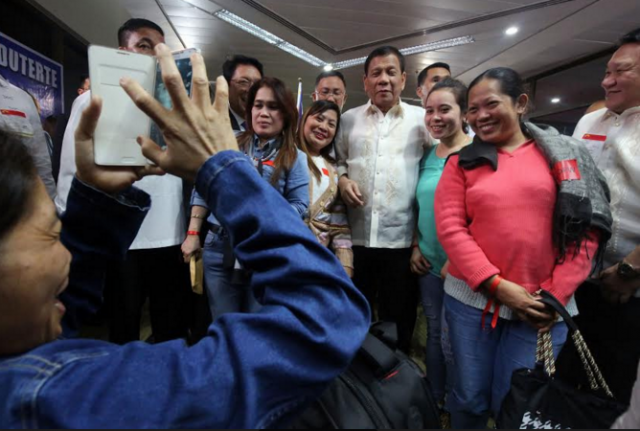 Duterte with repatriated OFWs