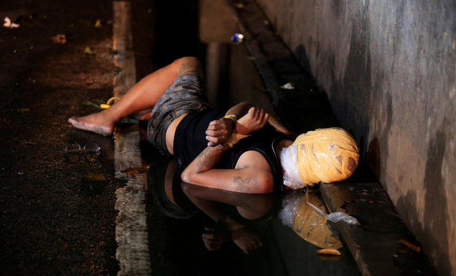 ejk-victim_reuters - 4 things that can happen to make Duterte govt accountable for continued killings - Talk of the Town