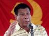 Rodrigo Duterte in front of CPP-NPA flag_Reuters file