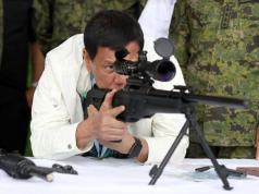 Duterte checks rifle sight