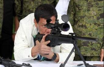 Duterte checks rifle sight