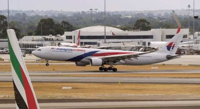 A Malaysia Airlines Airbus A330 commercial flight lands at Perth International Airport