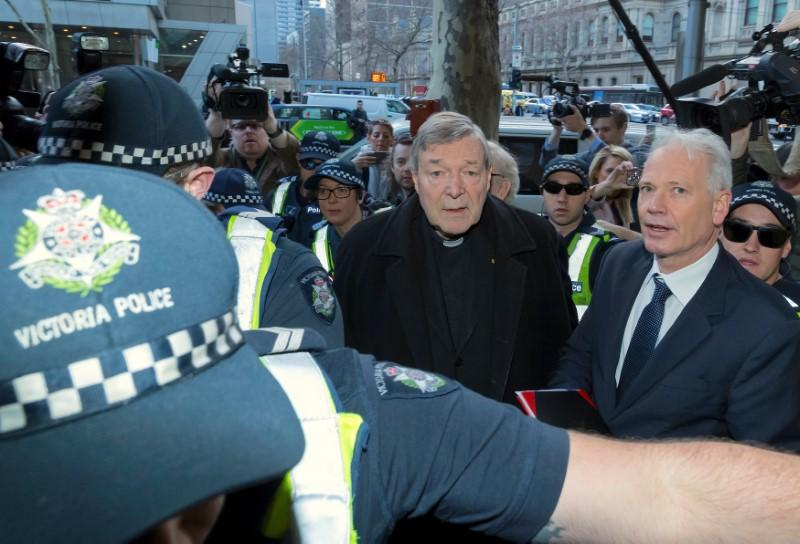 Top Vatican official Cardinal George Pell heads to court on historic day