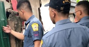 QC cops door-to-door