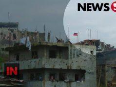 flag over Marawi ruins