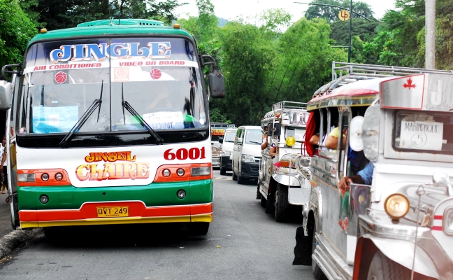 Marcos crowd buses, jeepneys