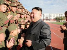Kim Jong Un with cheering cadets