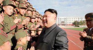 Kim Jong Un with cheering cadets
