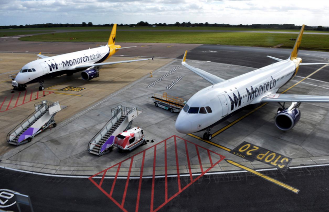 Two grounded Monarch aircraft after the airline ceased trading at Luton airport Britain