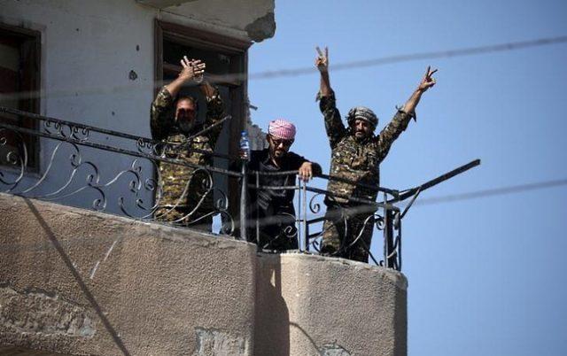 V sign in Raqqa