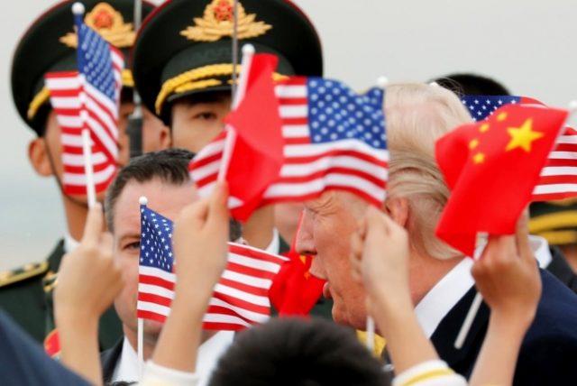 Trump_arrives_Beijing-648_REU