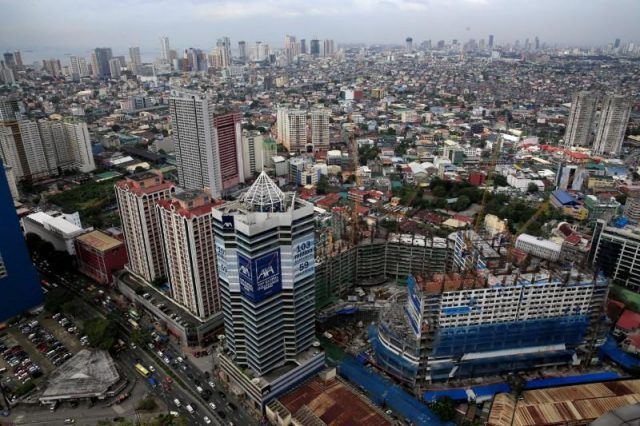Construction of new buildings alongside older establishments is seen within the business district in Makati City, metro Manila
