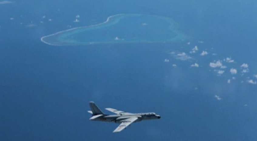 Beijing warns United States  away from disputed reefs in South China Sea