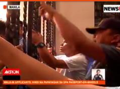 Jammed_passport_on_wheels_processing_Manila_News5grab