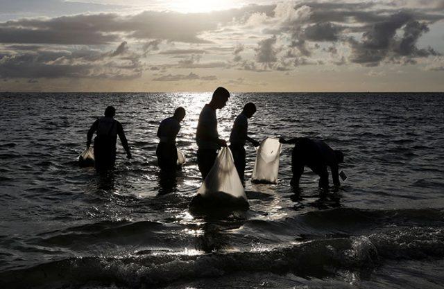 Cops collecting trash in Boracay