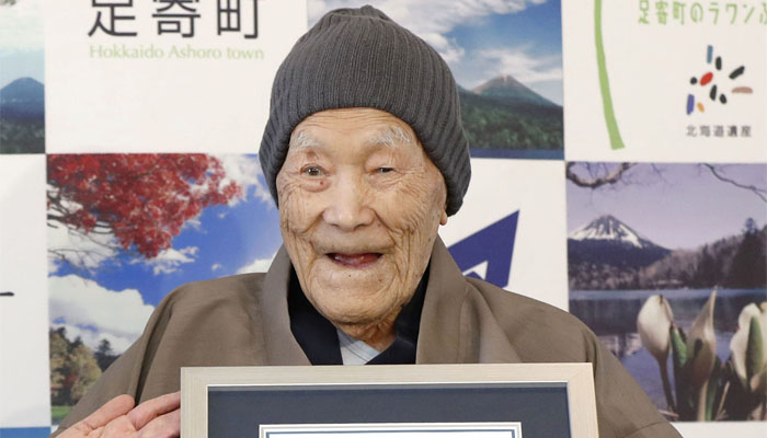Oldest man enjoys candies , soaking in Japan's hot springs