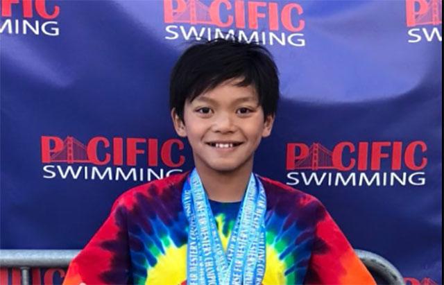 Super swimmer! Kid actually named Clark Kent breaks longstanding Michael Phelps record