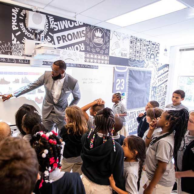 4fda52c4300e NBA star Lebron James interacts with children during the opening of his I  Promise School ...
