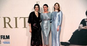 Actors Rachel Weisz, Olivia Colman and Emma Stone pose at the UK Premiere of The Favourite during the London Film Festival