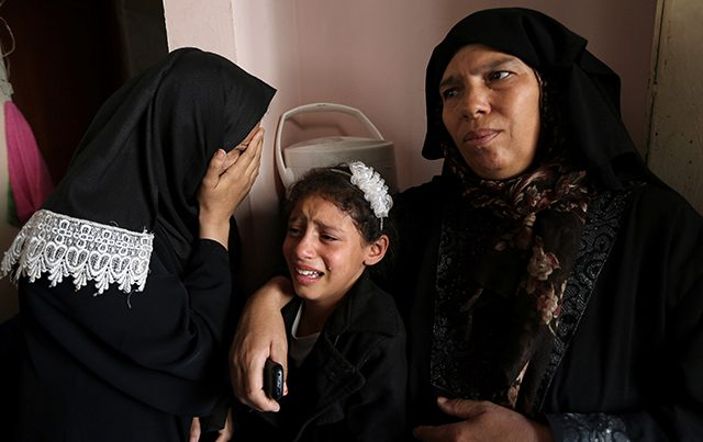 Relatives of Palestinian man Ahmed Abu Lebda, 22, who was killed during a protest at the Israel-Gaza border fence, mourn during his funeral in Khan Younis in the southern Gaza Strip
