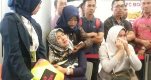Relatives of passengers of Lion Air flight JT610 that crashed into the sea, cry at Depati Amir airport in Pangkal Pinang