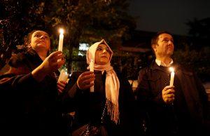 Demonstrators hold candles for Saudi journalist