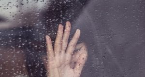 Crying on a window