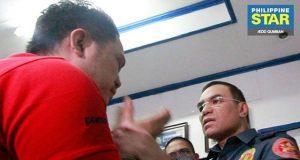 PO1 Edgardo Valencia and NCRPO Chief Guillermo Eleazar