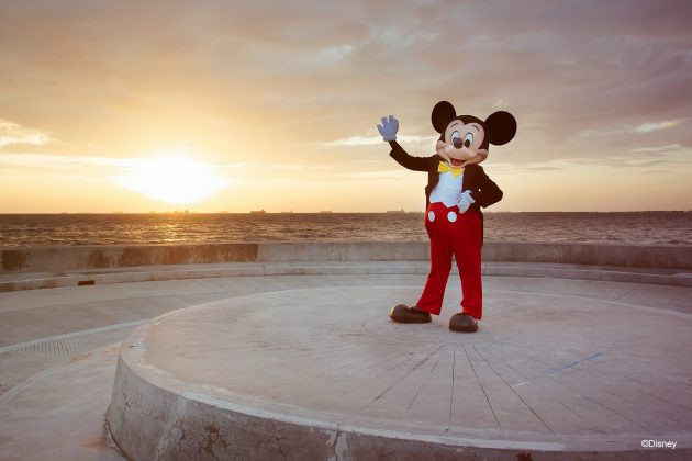 Mickey Mouse stands near Manila Bay