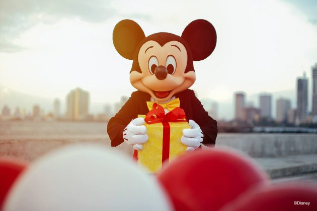 Mickey Mouse holding a box
