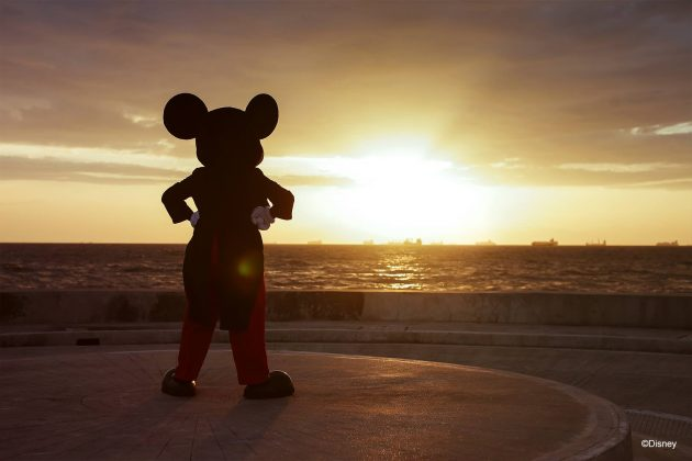 Mickey Mouse looks at the sunset