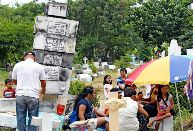 Filipinos in cemetery