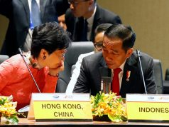 Hong Kong Chief Executive Carrie Lam talks to Indonesian President Joko Widodo at the APEC Summit, in Port Moresby