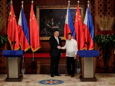 China's President Xi Jinping and Philippine President Rodrigo Duterte shake hands after a joint news statement at the Malacanang presidential palace in Manila