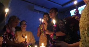 Residents affected by the tsunami attend a mass during Christmas at Carita Pentecostal Church in Pandeglang