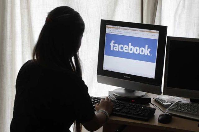 A girl accessing Facebook