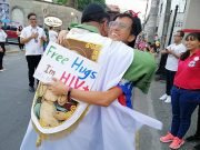 Priest hugs man with HIV