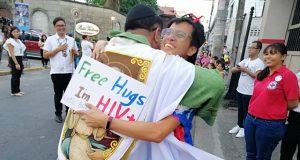 Priest hugs man with HIV