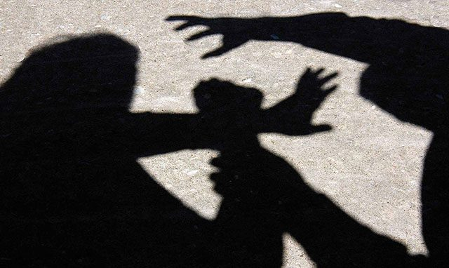 Silhouette of a woman fighting against a man