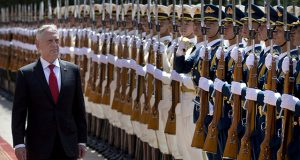 .S. Defense Secretary Jim Mattis reviews a Chinese honor guard during a welcome ceremony at the Bayi Building in Beijing