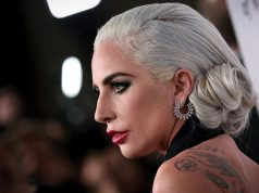 Lady Gaga poses for photographers as she arrives for the National Board of Review Awards gala in New York