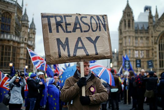 Pro-Brexit and anti-Brexit protesters demonstrate outside the Houses of Parliament in London