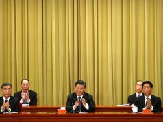 """Chinese President Xi Jinping applauds during an event to commemorate the 40th anniversary of the """"Message to Compatriots in Taiwan"""" at the Great Hall of the People in Beijing"""