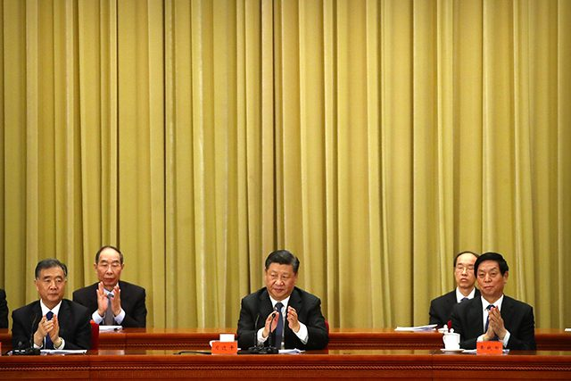 Chinese President Xi Jinping applauds during an event to commemorate the 40th anniversary of the