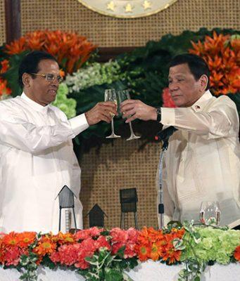 Duterte and Sirisena in a toast