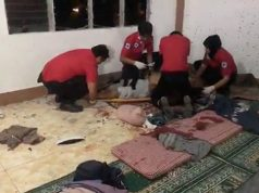 Rescue personnel work to resuscitate a victim after a grenade attack on a mosque in Zamboanga