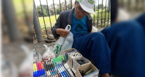 Old man selling pens