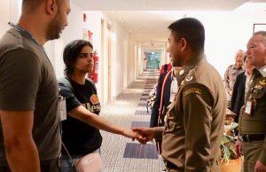 Saudi teen Rahaf Mohammed al-Qunun is greeted by Thai immigration authorities at a hotel inside Suvarnabhumi Airport in Bangkok