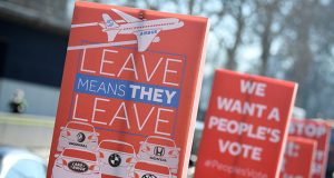 An anti-Brexit placard is seen outside of the Houses of Parliament in London, Britain