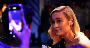 Captain Marvel cast member Brie Larson speaks to the media at a fan event in Singapore